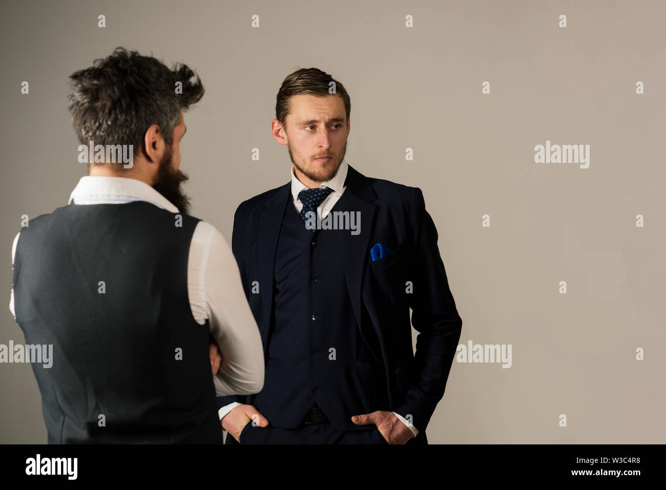 Style and status. Bonds of friendship and cooperation among businessmen. Fashion models in business relations. Men wear fashion business formal style. - Stock Image