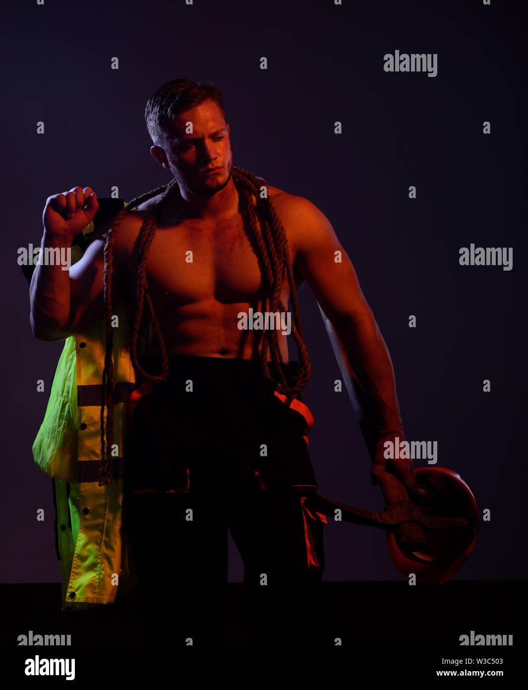 Remain under construction. Man miner with mining equipment. Hard worker with muscular torso. Muscular man worker. Construction worker. Mining area und - Stock Image