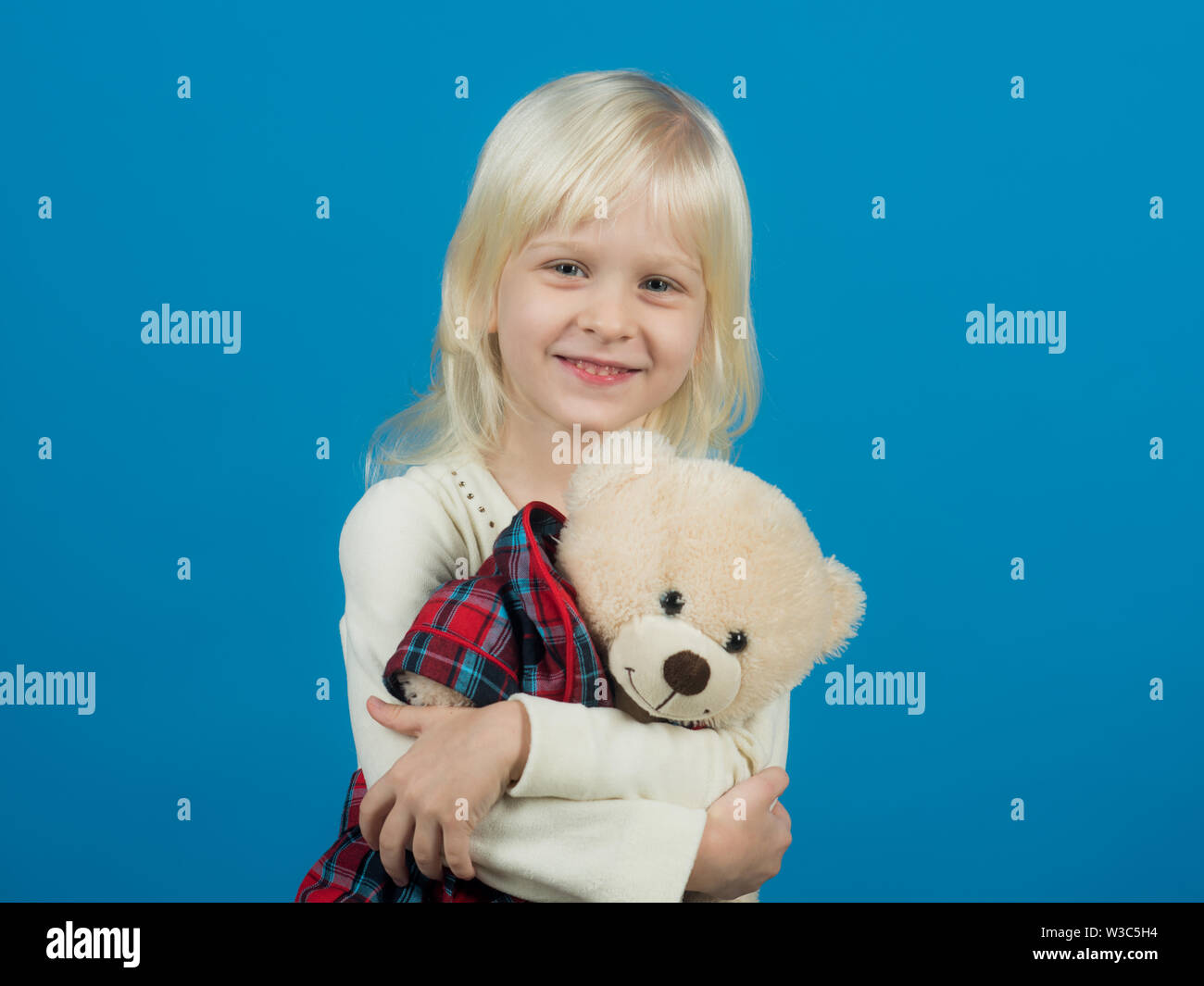Cuddly toy. Small kid happy smiling. Happy childhood. My favorite childhood toy. Little girl with teddy bear. Small girl hold toy bear. Little child w - Stock Image