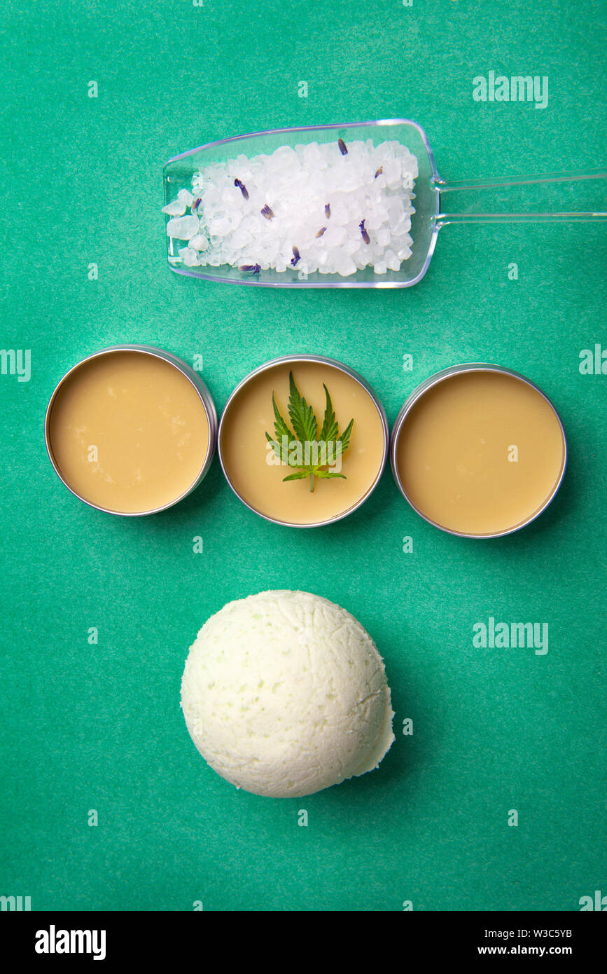 Assortment of cannabis wellness products with bath bomb, soaking salts and marijuana salve - cannabis spa concept Stock Photo