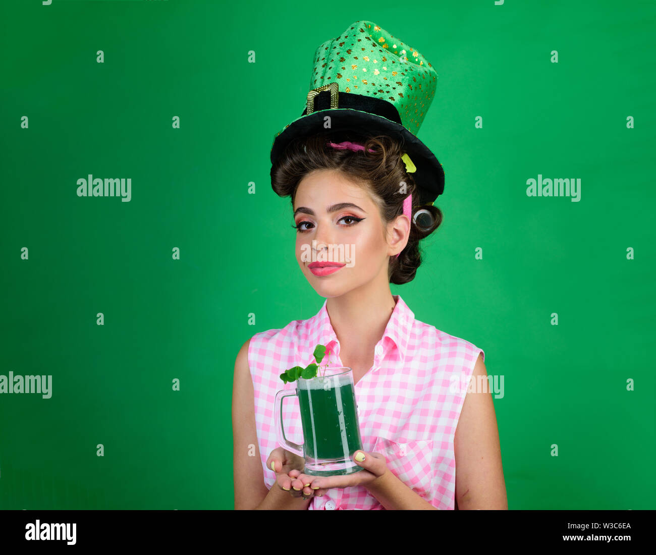 St. Patricks Day pretty girl in vintage style. pinup girl with fashion hair. pin up woman with trendy makeup. retro woman drink summer cocktail. Real - Stock Image