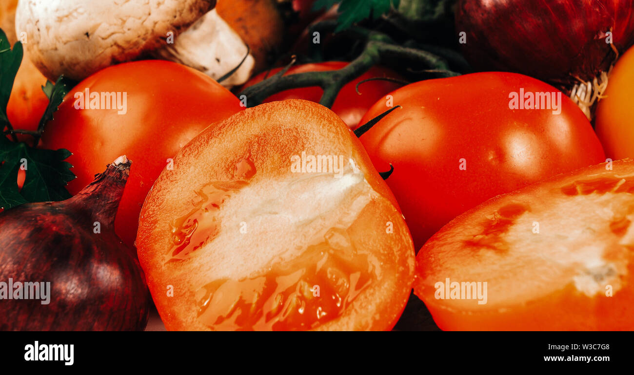 Sliced tomatoes with mushrooms and onion salad. Composition with raw vegetables - Stock Image