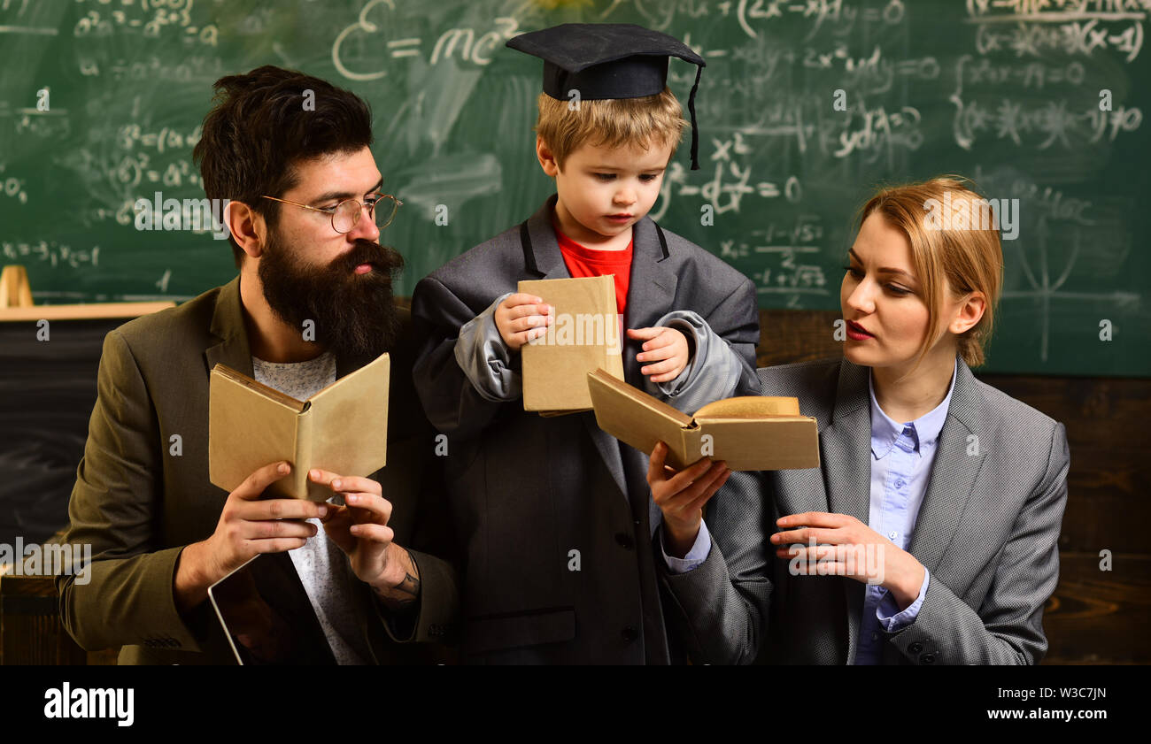 Teaching someone else is the best way to learn. Bearded man is tutor or teacher. Teacher or tutor helps preschool child. conference. Academic success - Stock Image