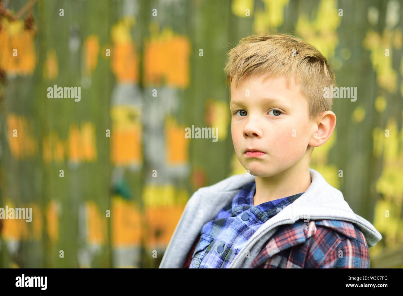 Serious and smart. Serious boy. Small boy look serious. Small child with thinking face. Focusing on something - Stock Image
