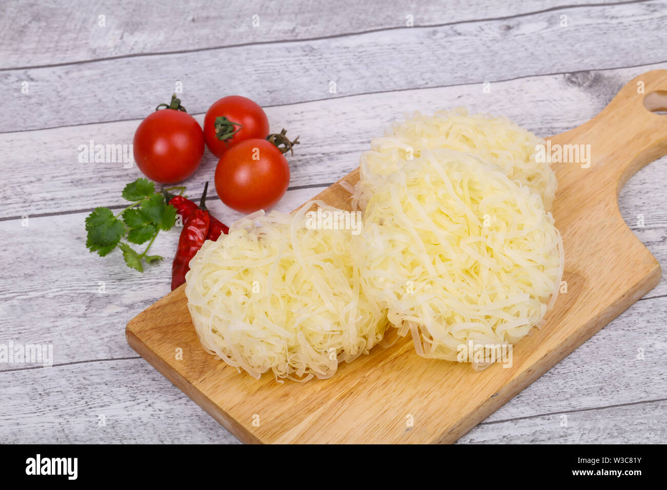 Raw rice noodle ready for cooking - Stock Image