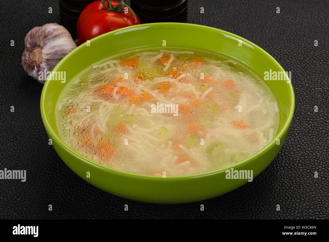 Chicken soup with noodles, carrot and celery - Stock Image