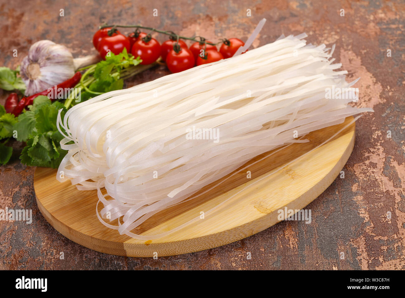 Raw rice noodles served cilantro leaves - Stock Image