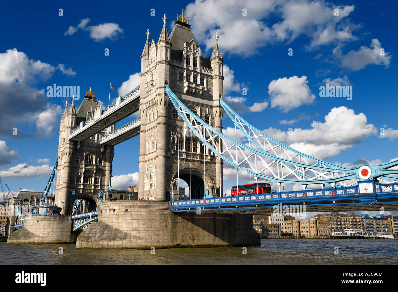 Twin stone towers of Tower Bridge over the Thames River in