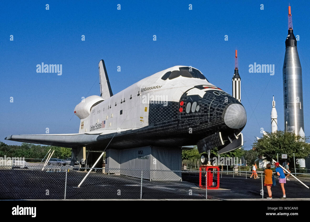 A mock-up of a Space Shuttle orbiter designed to transport astronauts and cargo to and from the International Space Station circling our planet was on display outdoors at the Kennedy Space Center near Cape Canaveral in Florida, USA, when this photograph was taken in 1976. The Ambassador was a full-size replica of six rocket-boosted shuttles that made 135 flights while being operated by the United States National Aeronautics and Space Administration (NASA) from 1981 to 2011. Nowadays the last of those retired space shuttles to fly, the Atlantis, is on exhibit at the Kennedy Space Center. Stock Photo