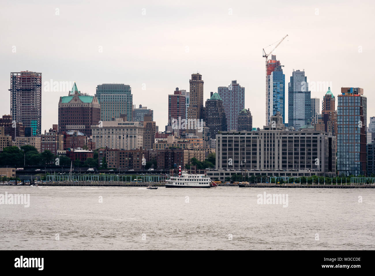 New York, USA - June 7, 2019:  Skyline and modern office buildings of Midtown Manhattan viewed from across the Hudson River. - Image - Stock Image