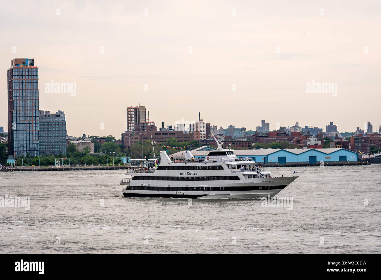 New York, USA - June 7, 2019:  Tourist boats on East River in front of Manhattan, A East River ferry boat travels the Hudson River - Image - Stock Image