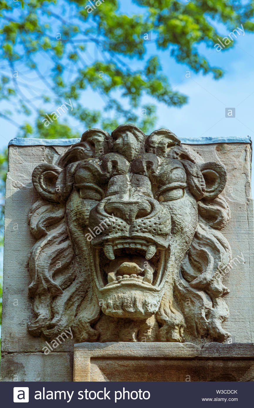 Lion from demolished building in the sculpture garden at Guild Park in Toronto Ontario Canada - Stock Image