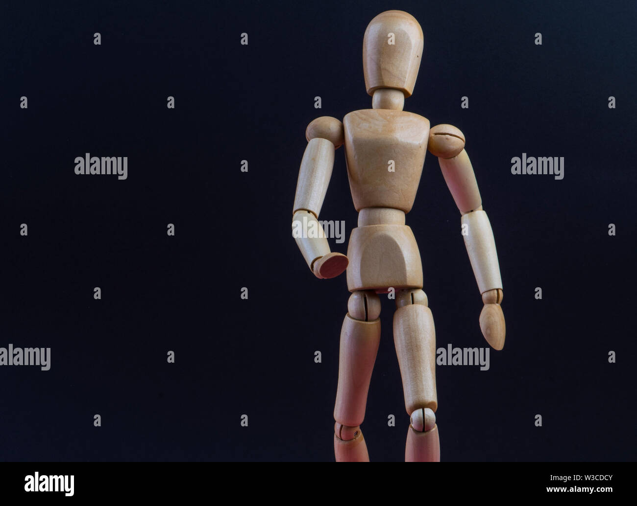 wooden mannequin in action and movement - Stock Image