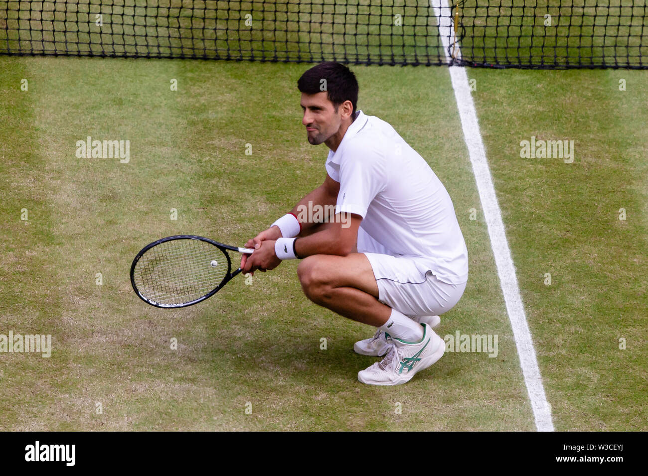 London, UK, 14th July 2019: Novak Djokovic from Serbia cheers after his 2019 Wimbledon victory at the All England Lawn Tennis and Croquet Club in London. Credit: Frank Molter/Alamy Live news Stock Photo