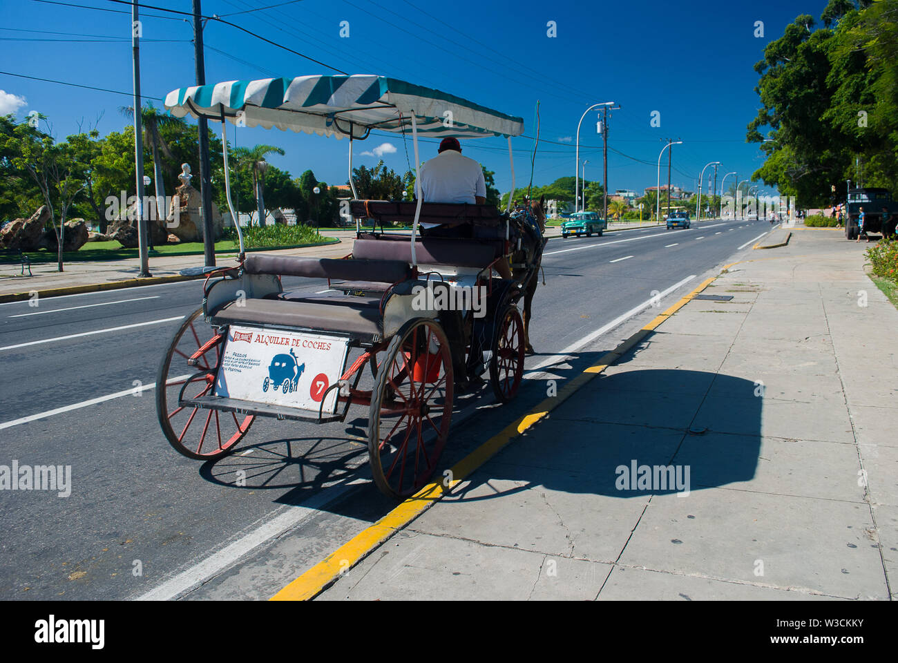 Matanzas, Varadero - Cuba / October 11 2011, Horse carriage and driver are waiting for tourists on streets of Cuban town Matanzas - Stock Image