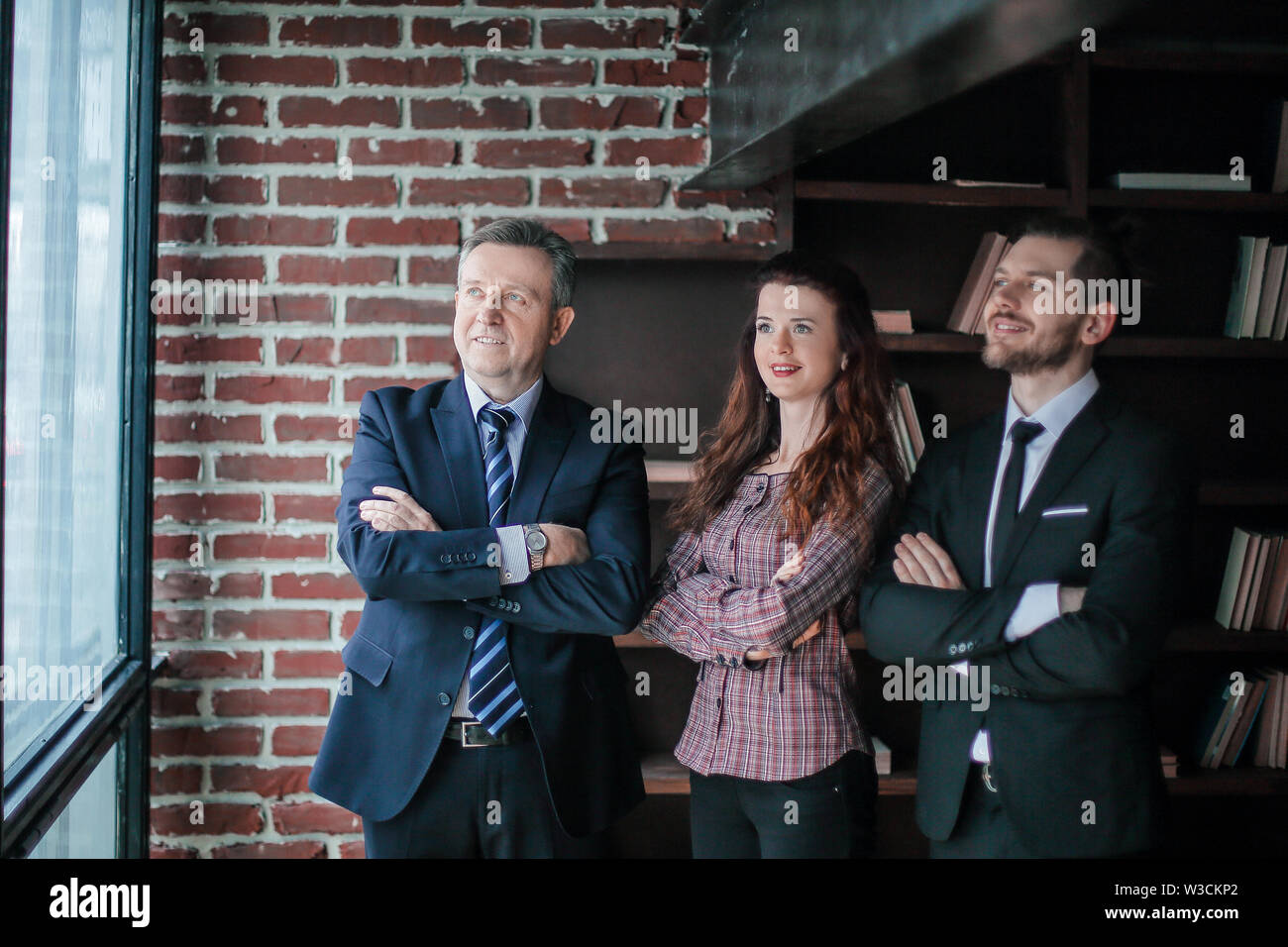 group of business partners standing in office.cooperation and perspective. - Stock Image