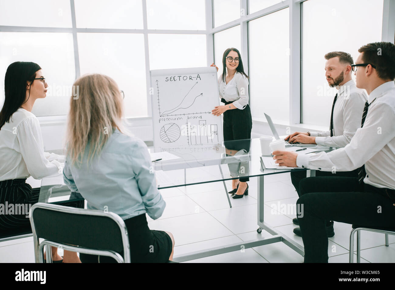 businesswoman doing a presentation for the employees of the company. the concept of a startup - Stock Image