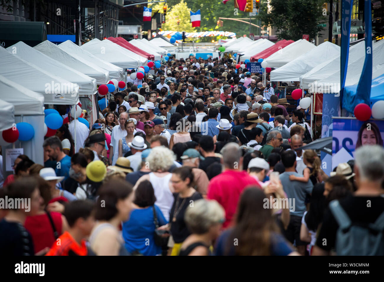 New York, USA. 14th July 2019. New York, French National Day. 14th July, 1789. People attend the French Institute Alliance Francaise (FIAF)'s Bastille Day Celebration in New York, the United States, July 14, 2019. Bastille Day, also known as the French National Day, commemorates the start of the French Revolution and the storming of the Bastille in Paris on July 14, 1789. Credit: Michael Nagle/Xinhua/Alamy Live News - Stock Image