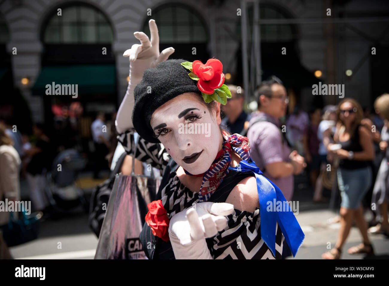 New York, USA. 14th July 2019. New York, French National Day. 14th July, 1789. Mime actress Catherine Gasta performs during the French Institute Alliance Francaise (FIAF)'s Bastille Day Celebration in New York, the United States, July 14, 2019. Bastille Day, also known as the French National Day, commemorates the start of the French Revolution and the storming of the Bastille in Paris on July 14, 1789. Credit: Michael Nagle/Xinhua/Alamy Live News - Stock Image