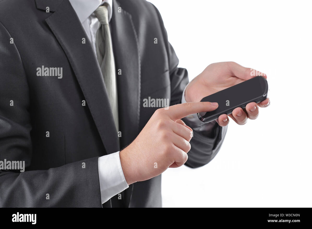 close up. businessman tapping the screen of the smartphone.photo with copy space - Stock Image