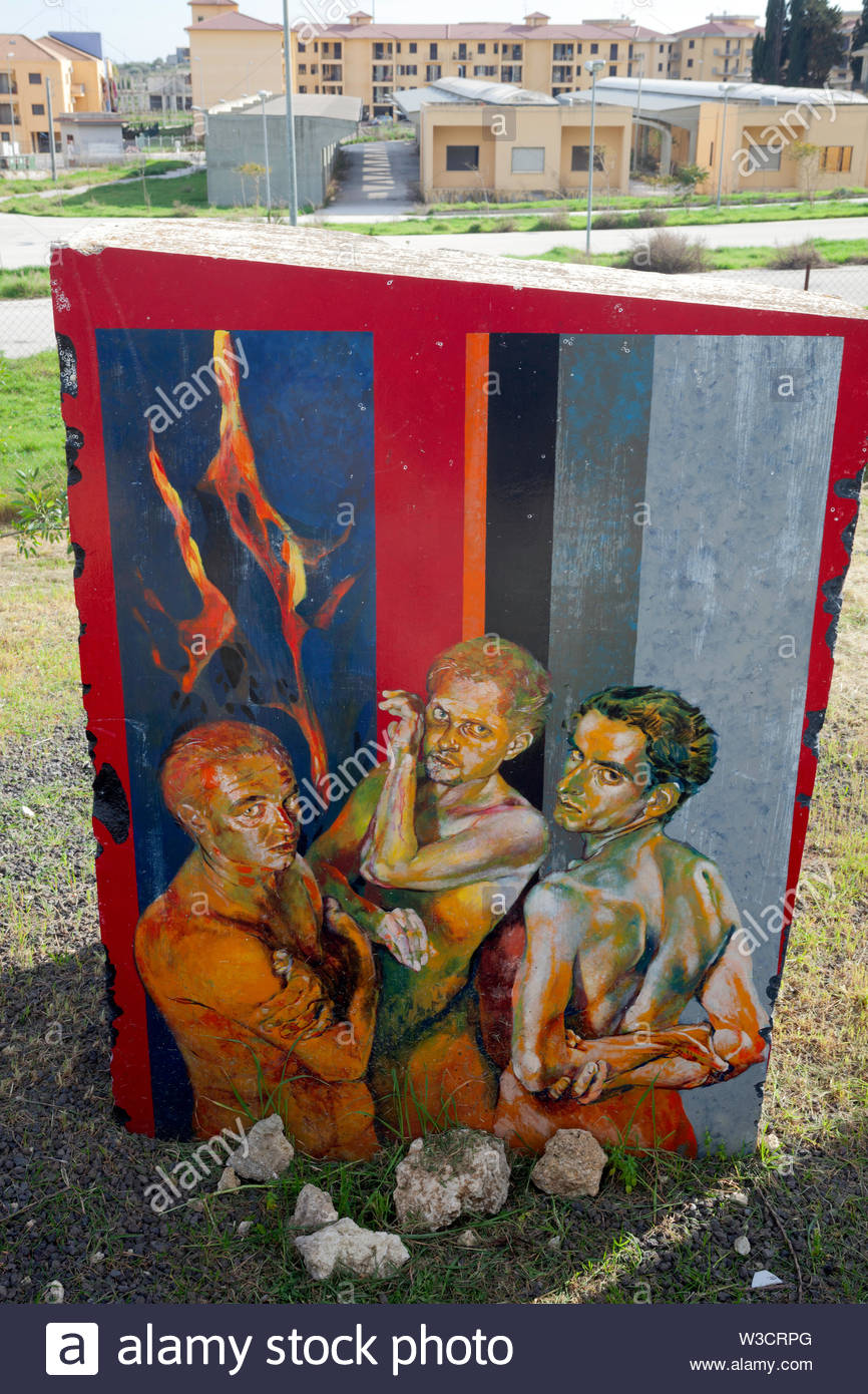 Painted stone representing scene of Dante's Divine Comedy, in this case three sods Stock Photo
