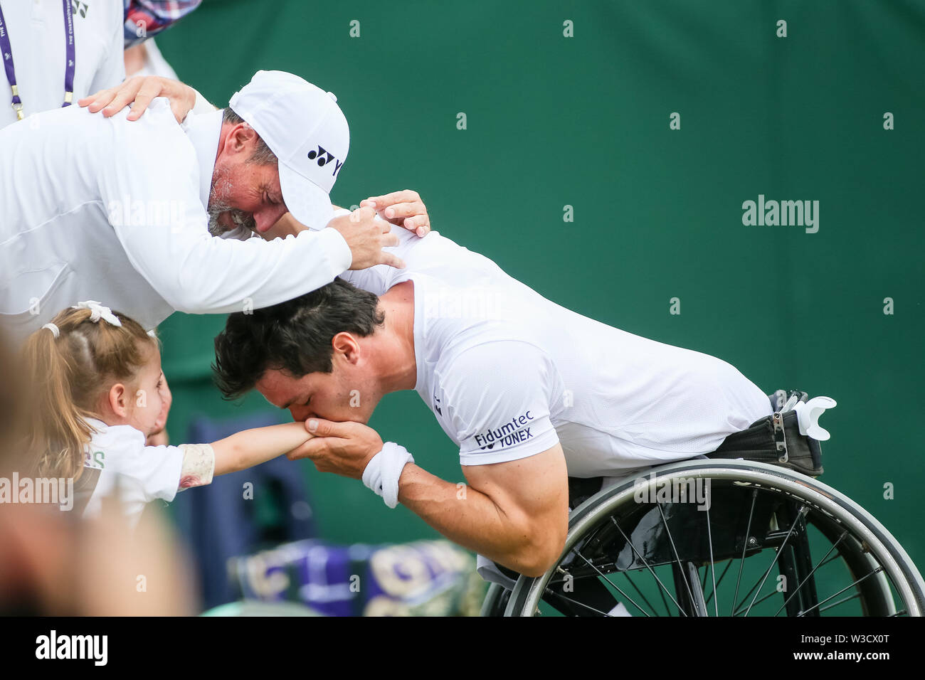 Wimbledon, London, UK. 14th July 2019. Gustavo Fernandez of Argentina kisses his daughter after winning the men's wheelchair singles final match of the Wimbledon Lawn Tennis Championships against Shingo Kunieda of Japan at the All England Lawn Tennis and Croquet Club in London, England on July 14, 2019. Credit: AFLO/Alamy Live News - Stock Image