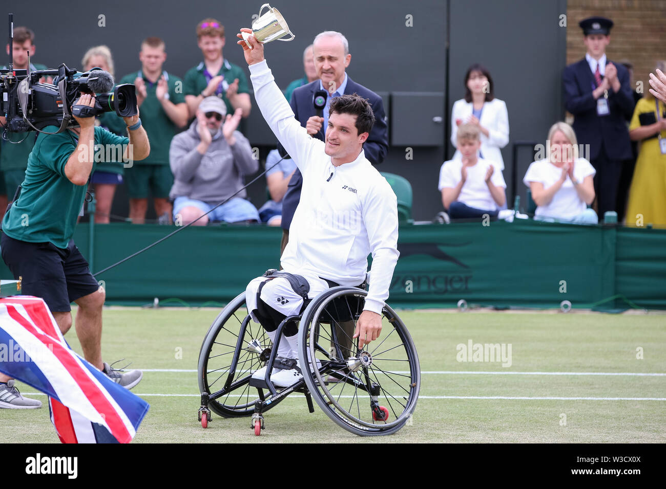 Wimbledon, London, UK. 14th July 2019. Gustavo Fernandez of Argentina poses with the trophy after winning the men's wheelchair singles final match of the Wimbledon Lawn Tennis Championships against Shingo Kunieda of Japan at the All England Lawn Tennis and Croquet Club in London, England on July 14, 2019. Credit: AFLO/Alamy Live News - Stock Image