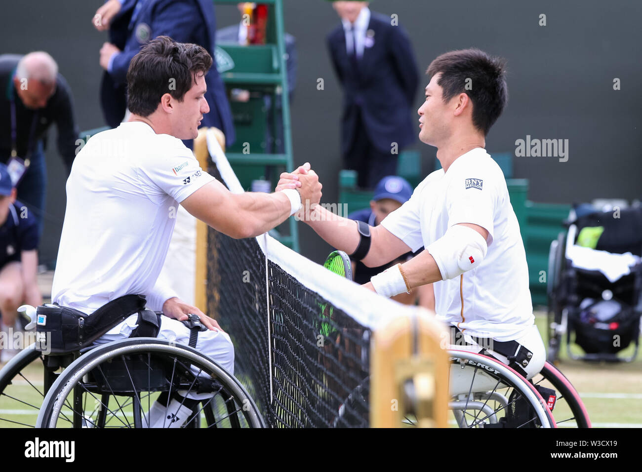 Wimbledon, London, UK. 14th July 2019. Shingo Kunieda of Japan and Gustavo Fernandez of Argentina greet each other after the men's wheelchair singles final match of the Wimbledon Lawn Tennis Championships at the All England Lawn Tennis and Croquet Club in London, England on July 14, 2019. Credit: AFLO/Alamy Live News - Stock Image