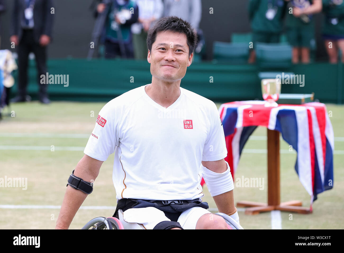 Wimbledon, London, UK. 14th July 2019. Shingo Kunieda of Japan smiles after the men's wheelchair singles final match of the Wimbledon Lawn Tennis Championships against Gustavo Fernandez of Argentina at the All England Lawn Tennis and Croquet Club in London, England on July 14, 2019. Credit: AFLO/Alamy Live News - Stock Image