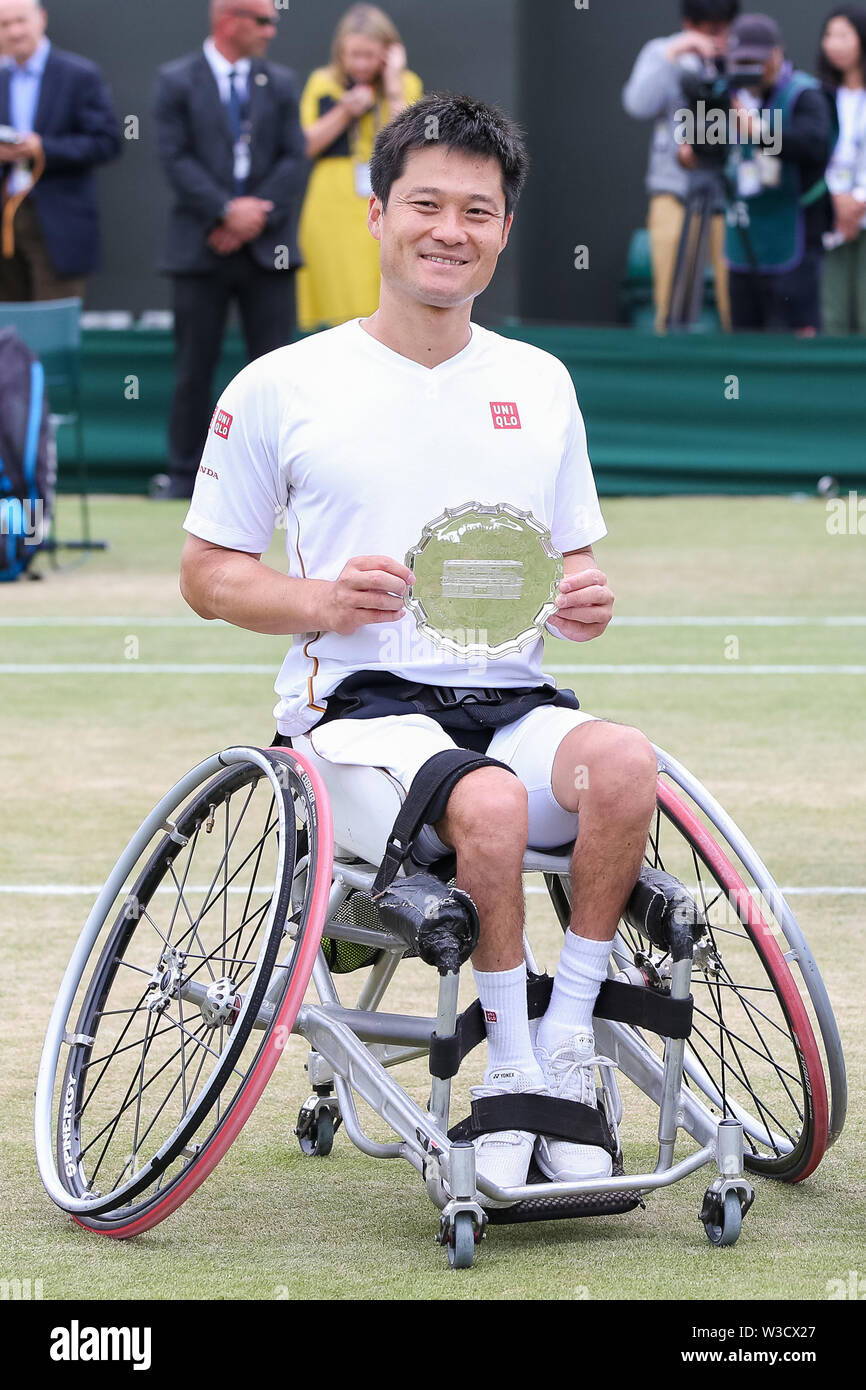 Wimbledon, London, UK. 14th July 2019. Shingo Kunieda of Japan poses with the trophy after the men's wheelchair singles final match of the Wimbledon Lawn Tennis Championships against Gustavo Fernandez of Argentina at the All England Lawn Tennis and Croquet Club in London, England on July 14, 2019. Credit: AFLO/Alamy Live News - Stock Image