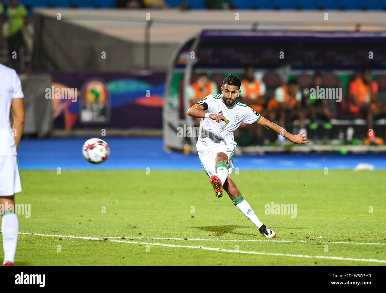 Cairo. 14th July, 2019. Riyad Mahrez of Algeria scores during the semifinal match between Algeria and Nigeria at the 2019 Africa Cup of Nations in Cairo, Egypt on July 14, 2019. Credit: Li Yan/Xinhua/Alamy Live News - Stock Image