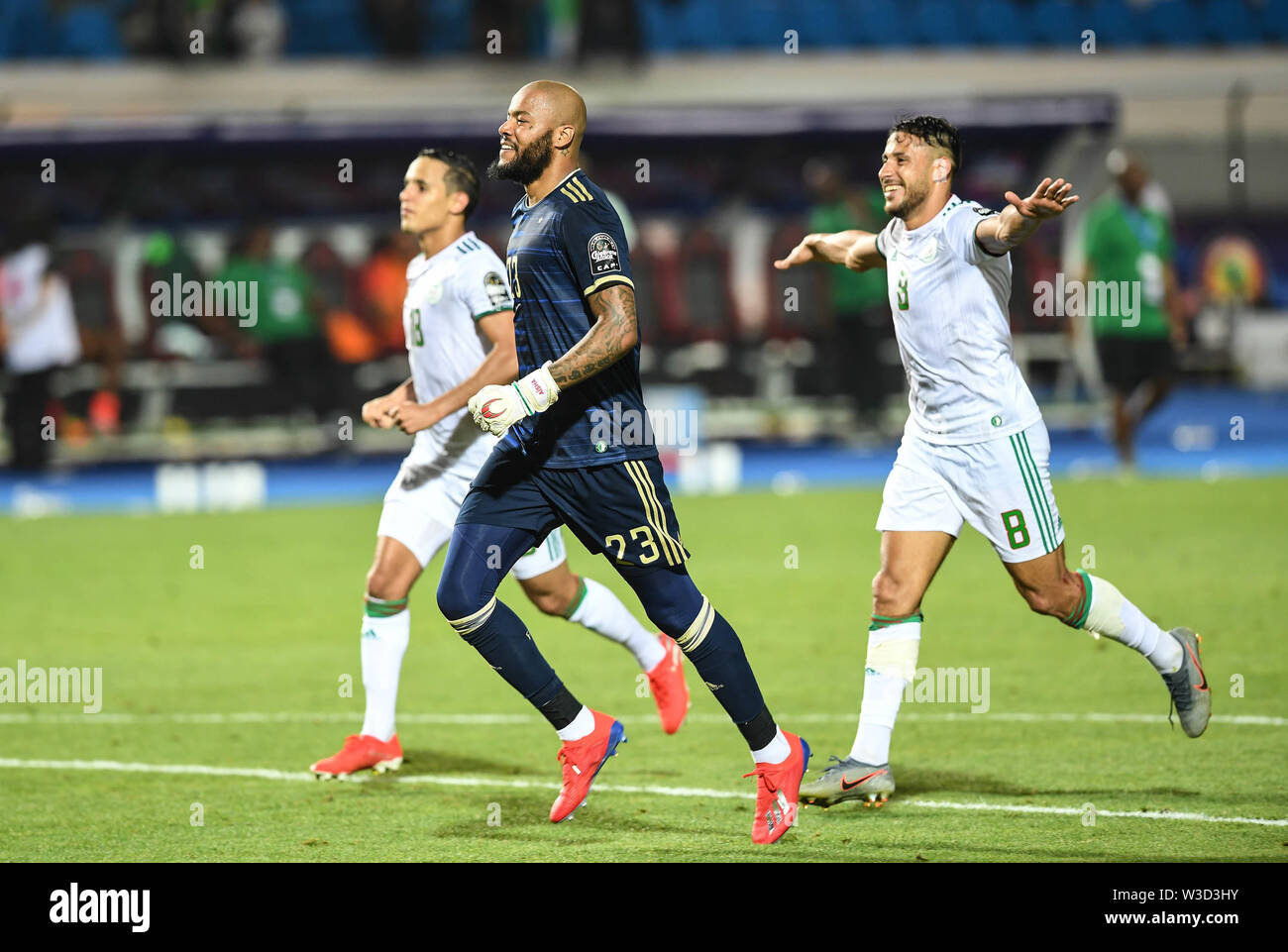 Cairo. 14th July, 2019. Players of Algeria celebrate the victory after the semifinal match between Algeria and Nigeria at the 2019 Africa Cup of Nations in Cairo, Egypt on July 14, 2019. Credit: Li Yan/Xinhua/Alamy Live News - Stock Image