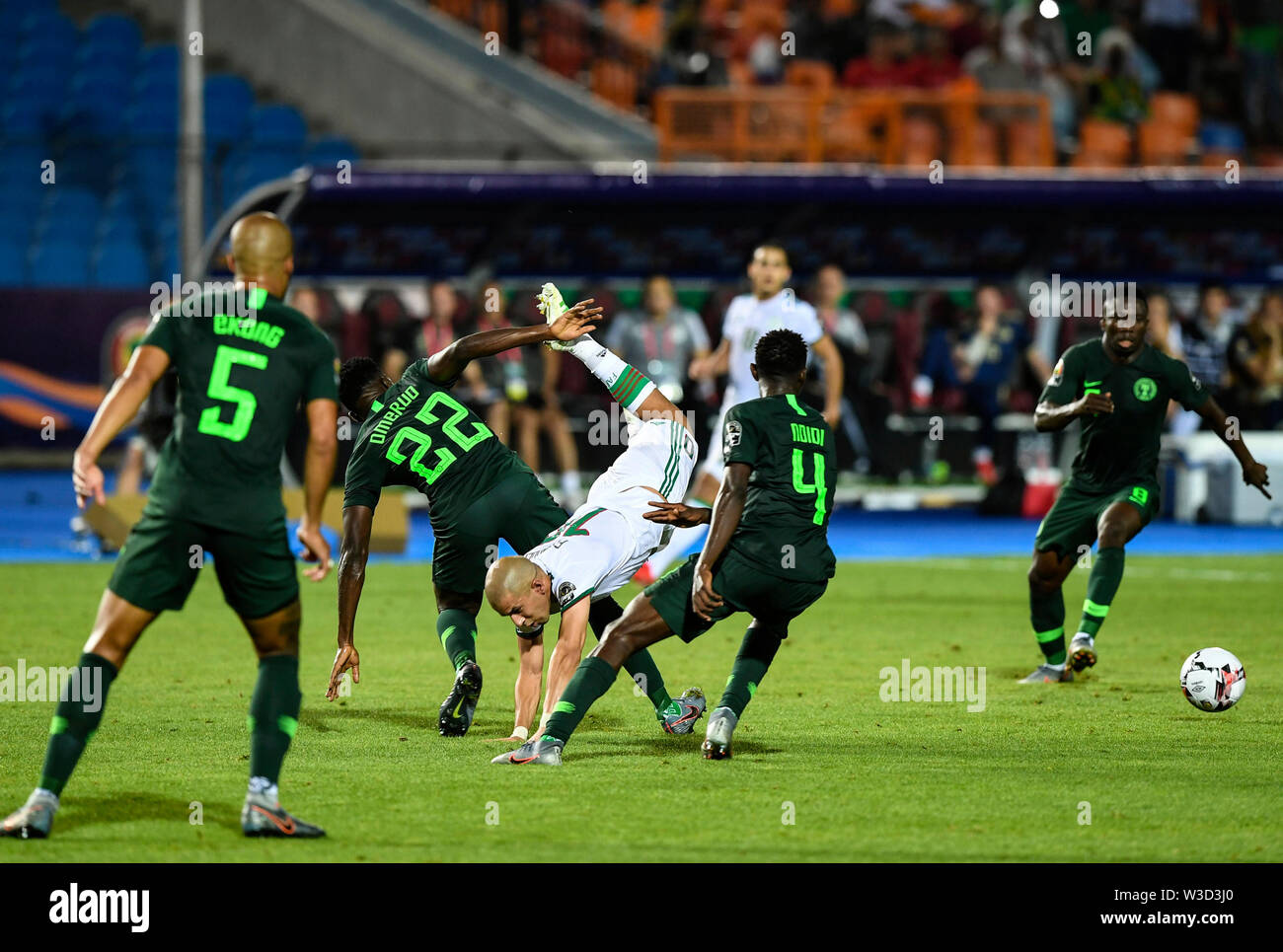 Cairo. 14th July, 2019. Sofiane Feghouli (3rd L) of Algeria competes with Kenneth Omeruo (2nd L) of Nigeria during the semifinal match between Algeria and Nigeria at the 2019 Africa Cup of Nations in Cairo, Egypt on July 14, 2019. Credit: Li Yan/Xinhua/Alamy Live News - Stock Image