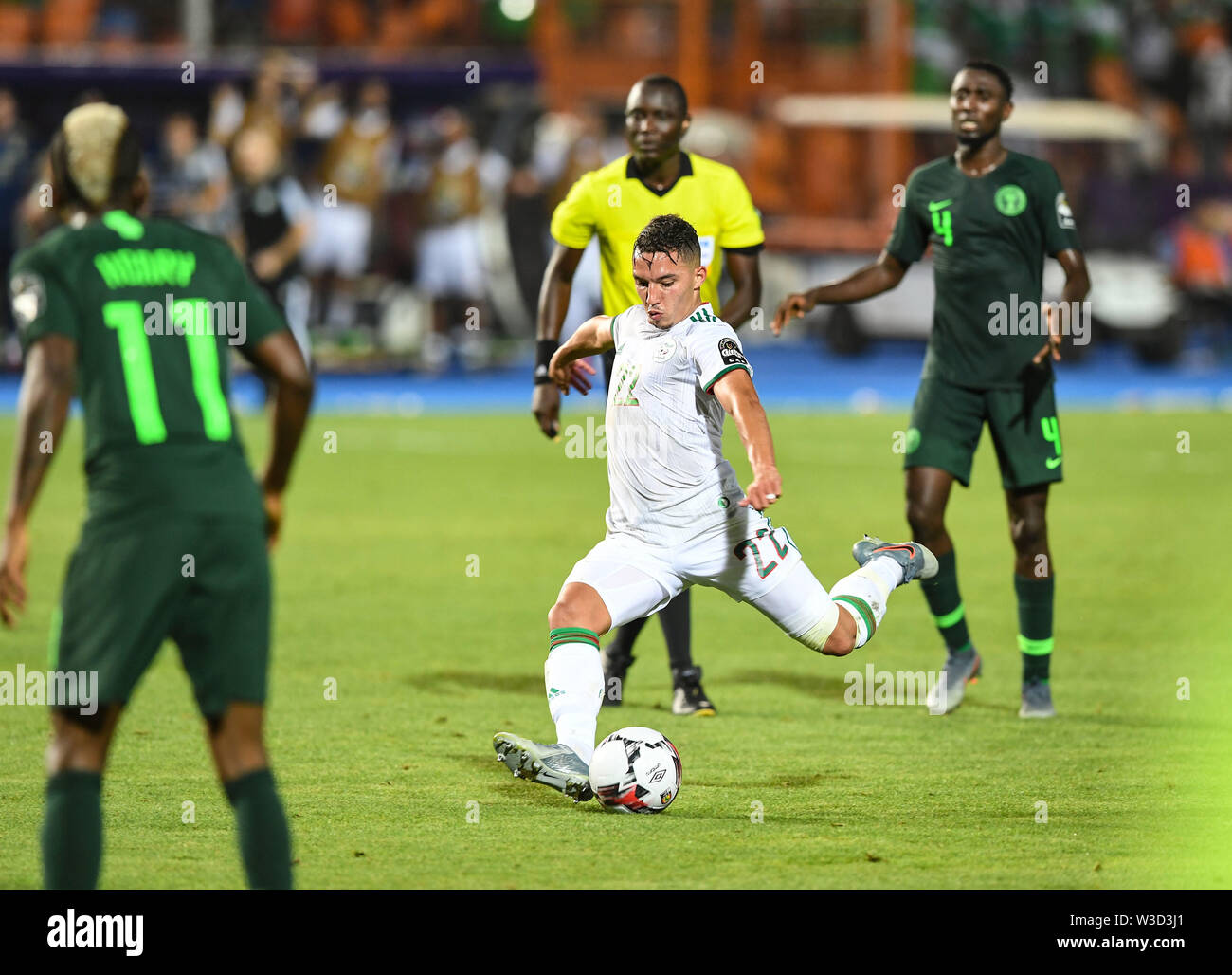 Cairo. 14th July, 2019. Ismael Bennacer of Algeria shoots during the semifinal match between Algeria and Nigeria at the 2019 Africa Cup of Nations in Cairo, Egypt on July 14, 2019. Credit: Li Yan/Xinhua/Alamy Live News - Stock Image