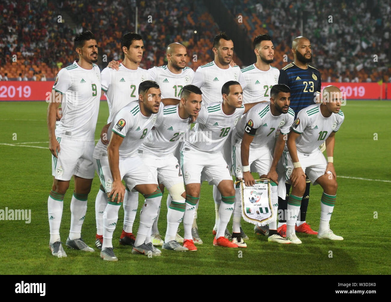 Cairo. 14th July, 2019. Players of Algeria pose for photos before the semifinal match between Algeria and Nigeria at the 2019 Africa Cup of Nations in Cairo, Egypt on July 14, 2019. Credit: Wu Huiwo/Xinhua/Alamy Live News - Stock Image