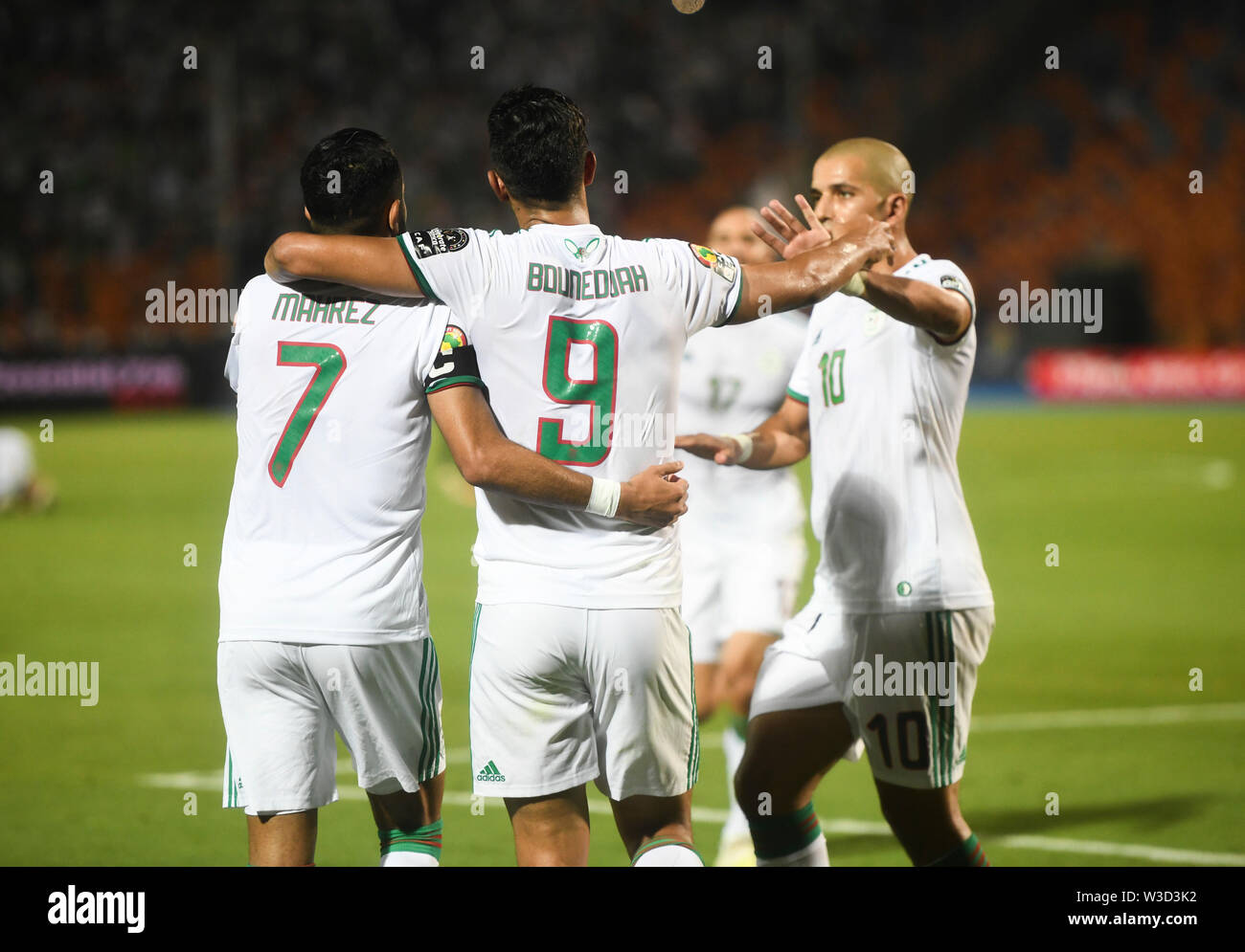 Cairo. 14th July, 2019. Players of Algeria celebrate after first scoring during the semifinal match between Algeria and Nigeria at the 2019 Africa Cup of Nations in Cairo, Egypt on July 14, 2019. Credit: Wu Huiwo/Xinhua/Alamy Live News - Stock Image