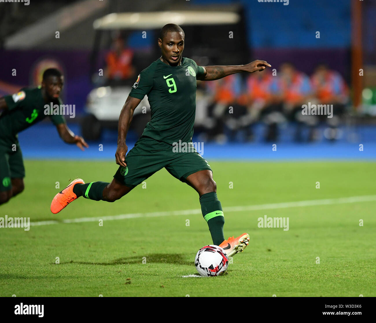 Cairo. 14th July, 2019. Odion Ighalo of Nigeria scores in a penalty shooting during the semifinal match between Algeria and Nigeria at the 2019 Africa Cup of Nations in Cairo, Egypt on July 14, 2019. Credit: Wu Huiwo/Xinhua/Alamy Live News - Stock Image