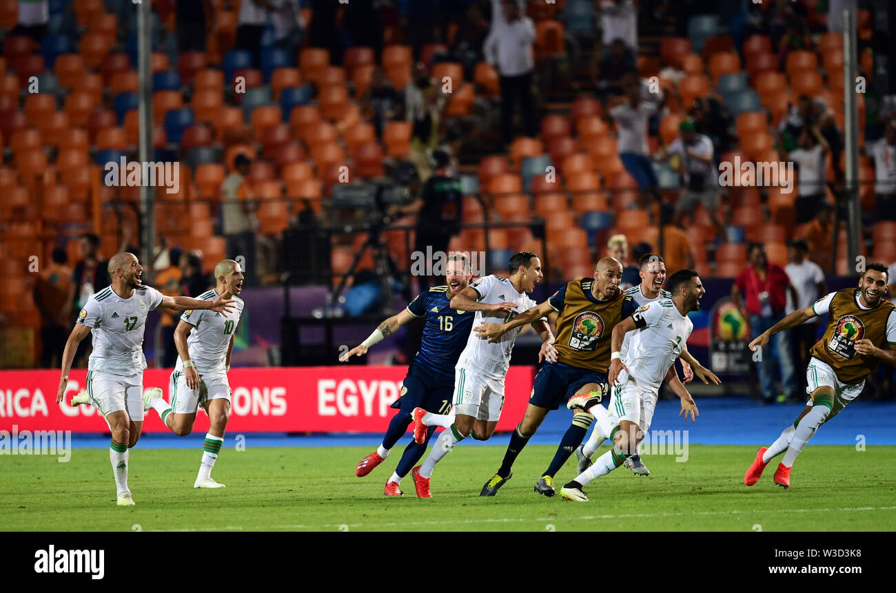 Cairo. 14th July, 2019. Players of Algeria celebrate after second scoring during the semifinal match between Algeria and Nigeria at the 2019 Africa Cup of Nations in Cairo, Egypt on July 14, 2019. Credit: Wu Huiwo/Xinhua/Alamy Live News - Stock Image