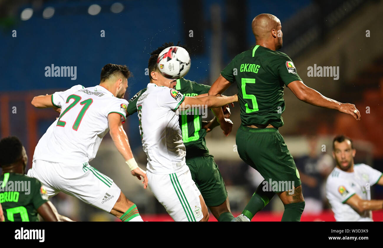 Cairo. 14th July, 2019. Baghdad Bounedjah (C) of Algeria competes during the semifinal match between Algeria and Nigeria at the 2019 Africa Cup of Nations in Cairo, Egypt on July 14, 2019. Credit: Wu Huiwo/Xinhua/Alamy Live News - Stock Image
