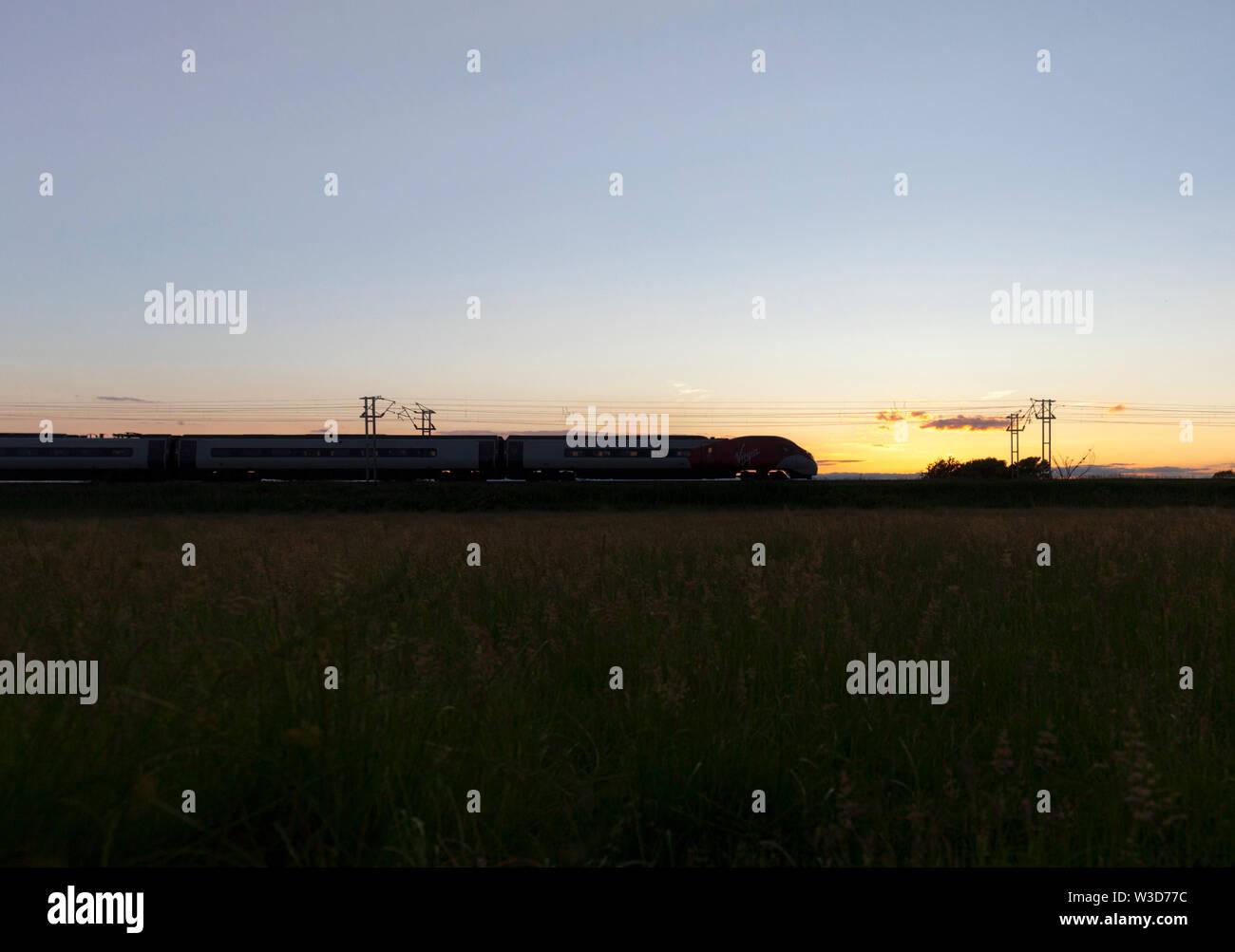 25/06/2019 Bolton Le Sands (south of Carnforth) 390xxx 1743 London Euston to Glasgow Central via Birmingham - Stock Image