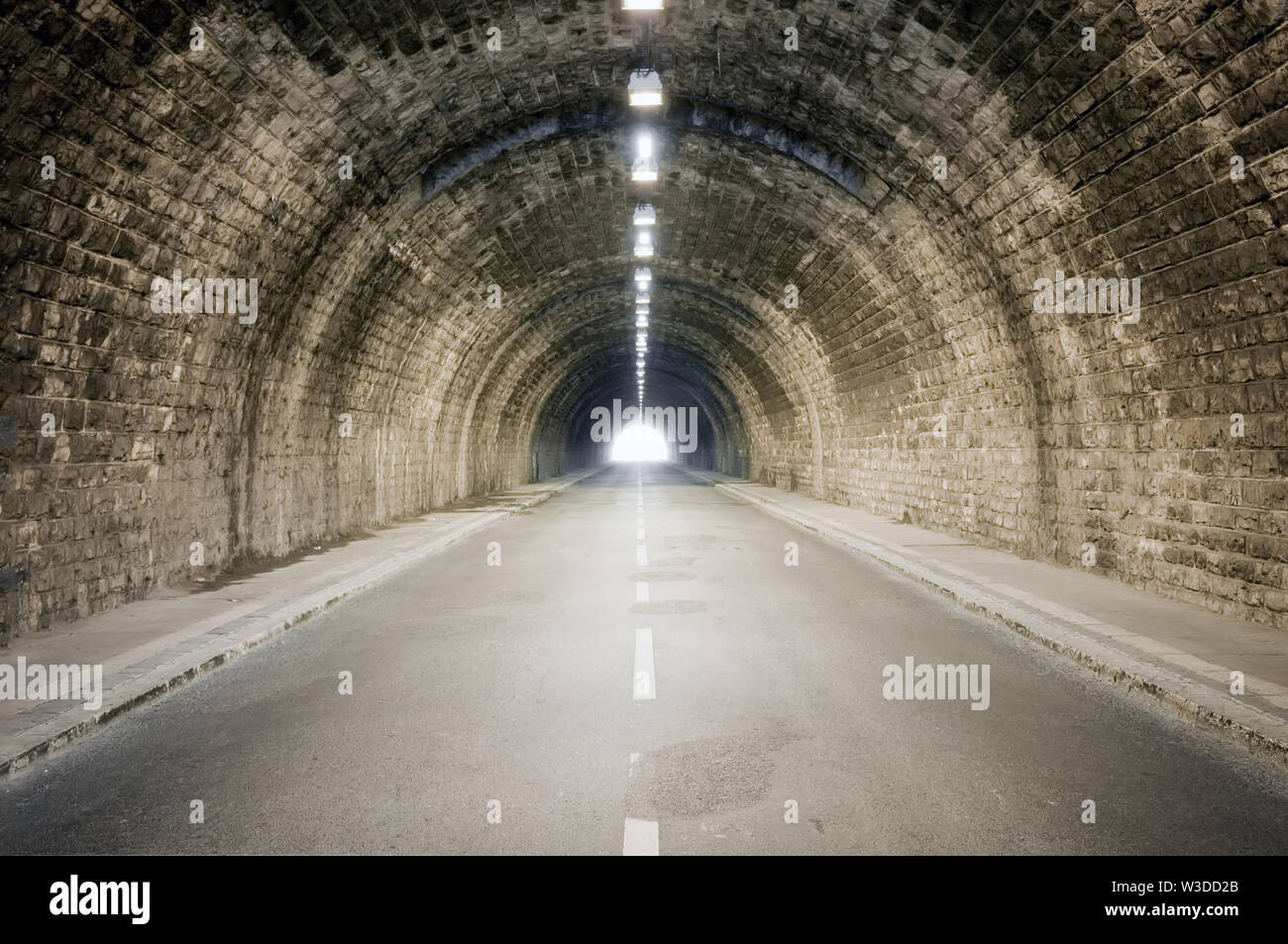 light at the dark tunnel vanishing point end - Stock Image