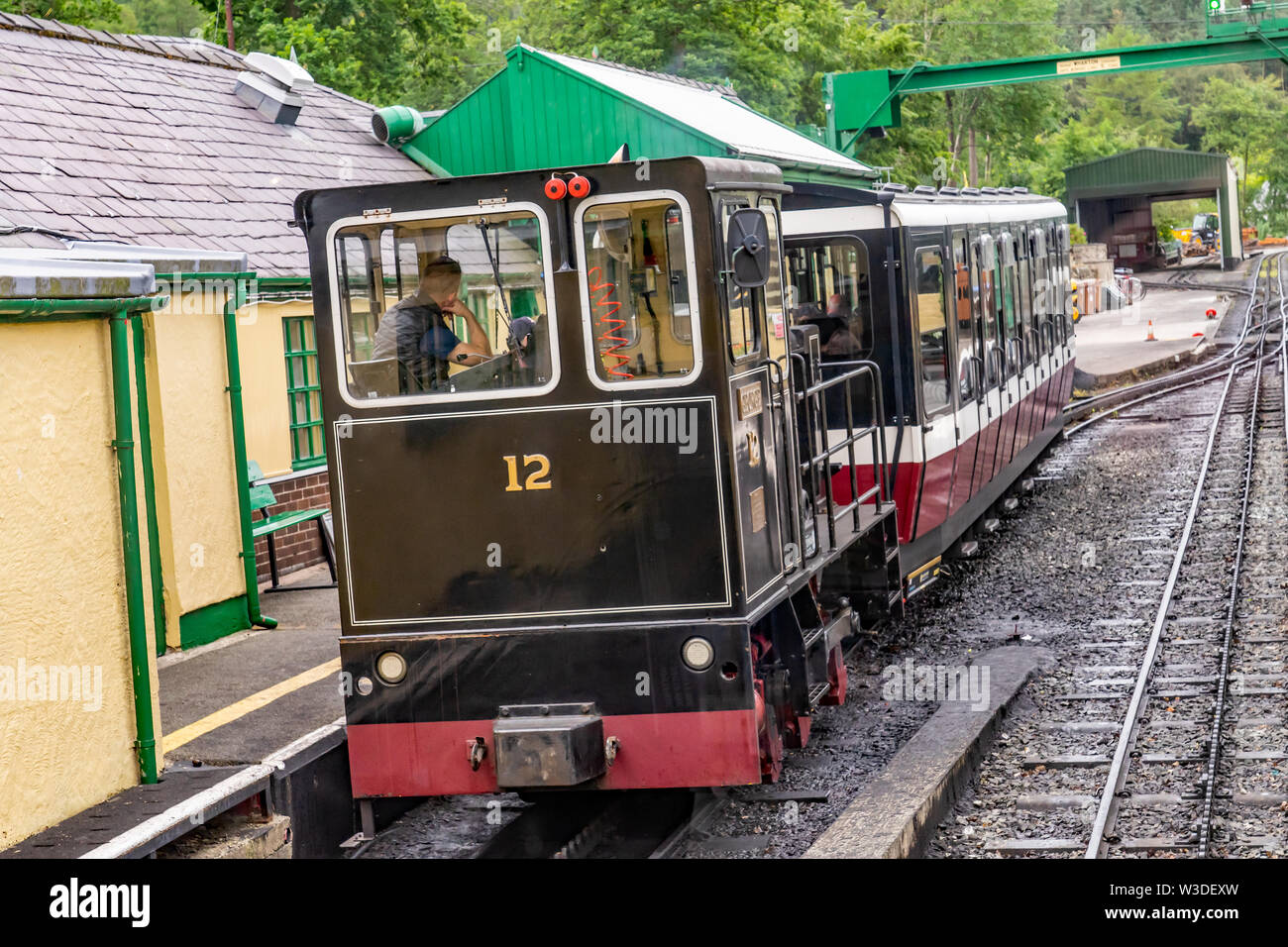 A diesel engine used on the Mount Snowdon Railway line parked up at Llanberis Station - Stock Image