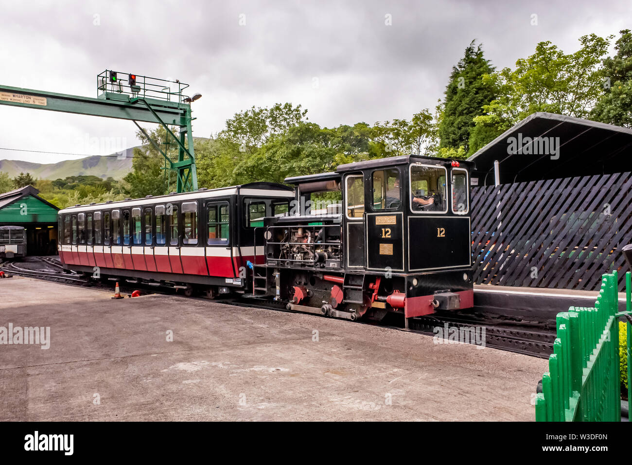 A diesel train in Llanberis train station used on the Mount Snowdon Railway used to carry passengers to the summit of Mount Snowdon - Stock Image