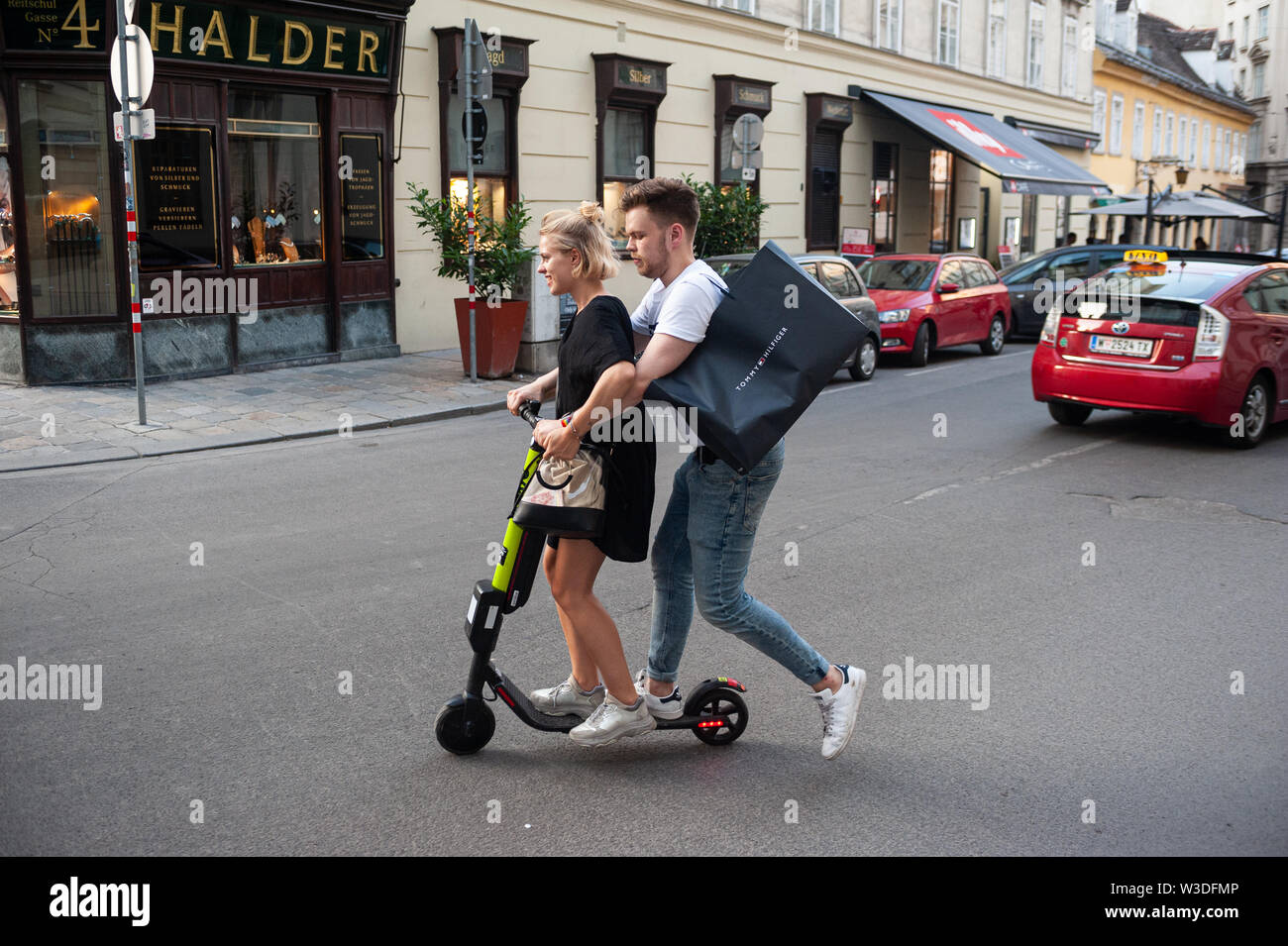 Woman Rides A Scooter Stock Photos & Woman Rides A Scooter