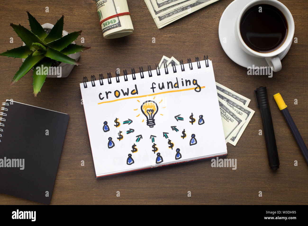 Notepad with crowdfunding concept laying on office table Stock Photo