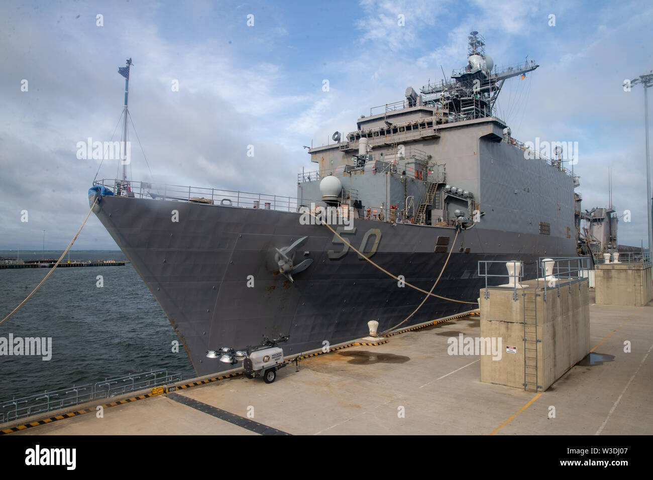 USS Carter Hall (LSD 50) Harpers Ferry Class docks at a pier on Naval Air Station Norfolk, Virginia, July 12, 2019. U.S. Marines with II Marine Expeditionary Force rehearsed a loading exercise with the U.S. Navy to rapidly form, embark and deploy maritime Defense Support for Civil Authorities operations in support of U.S. Northern Command. (U.S. Marine Corps photo by Lance Cpl. Adaezia Chavez) - Stock Image