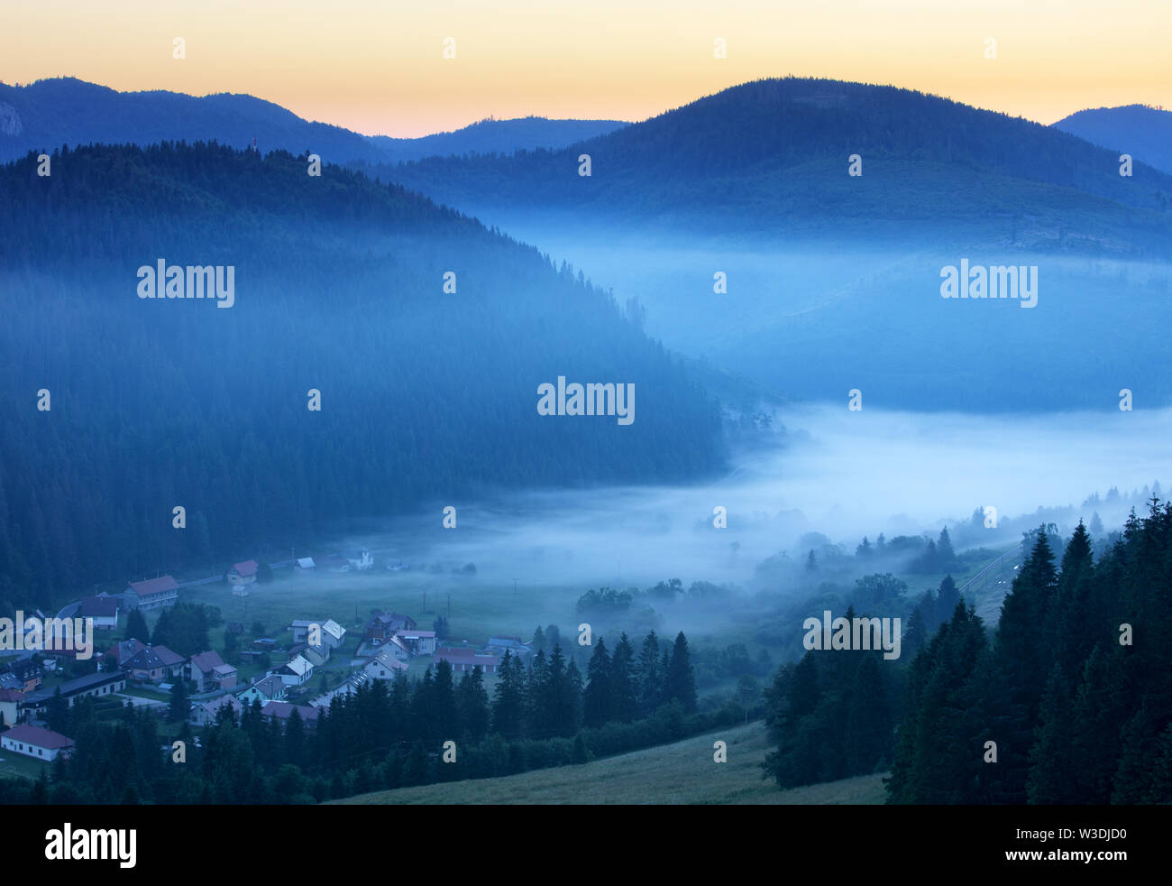 Meadow and hills at sunrise, Mlynky, Slovakia Stock Photo