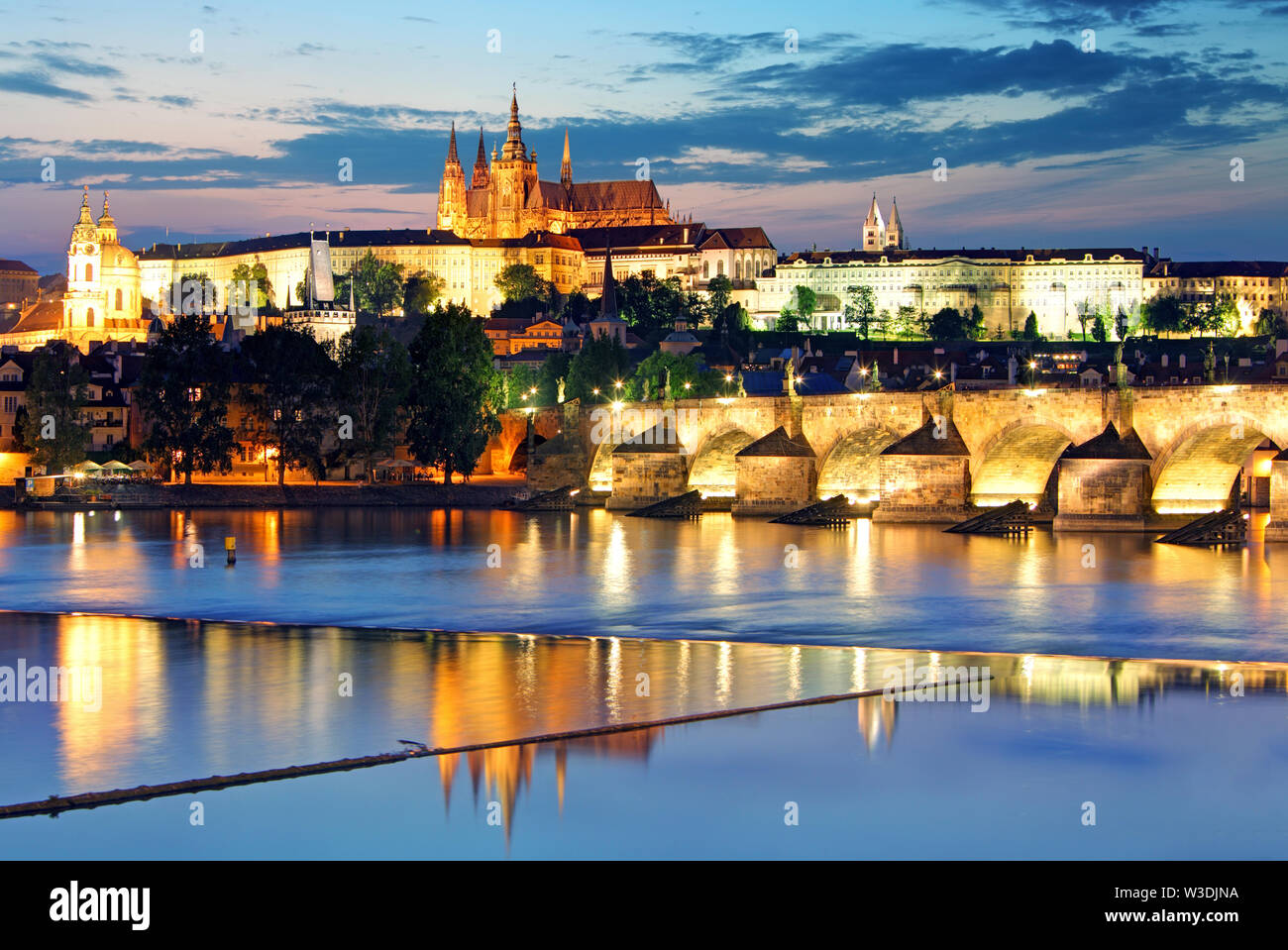 Prague castle and Charles bridge at night - Stock Image