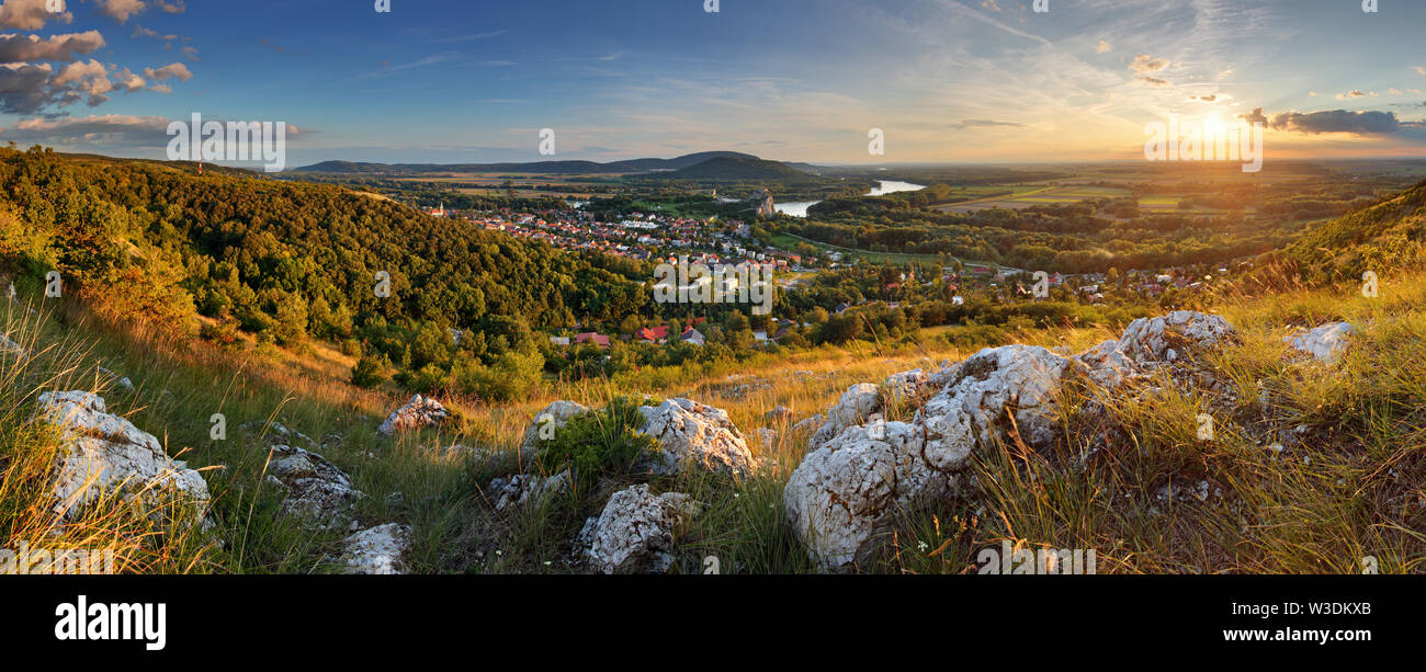 Bratilava panorama with village Devin at sunset - Stock Image
