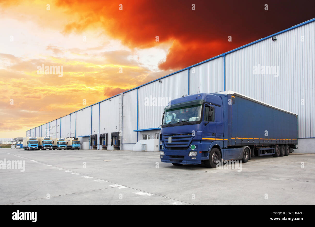 Truck at warehouse building Stock Photo